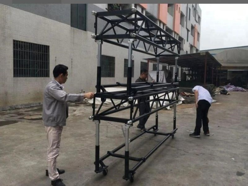 Pre-rig moving light truss